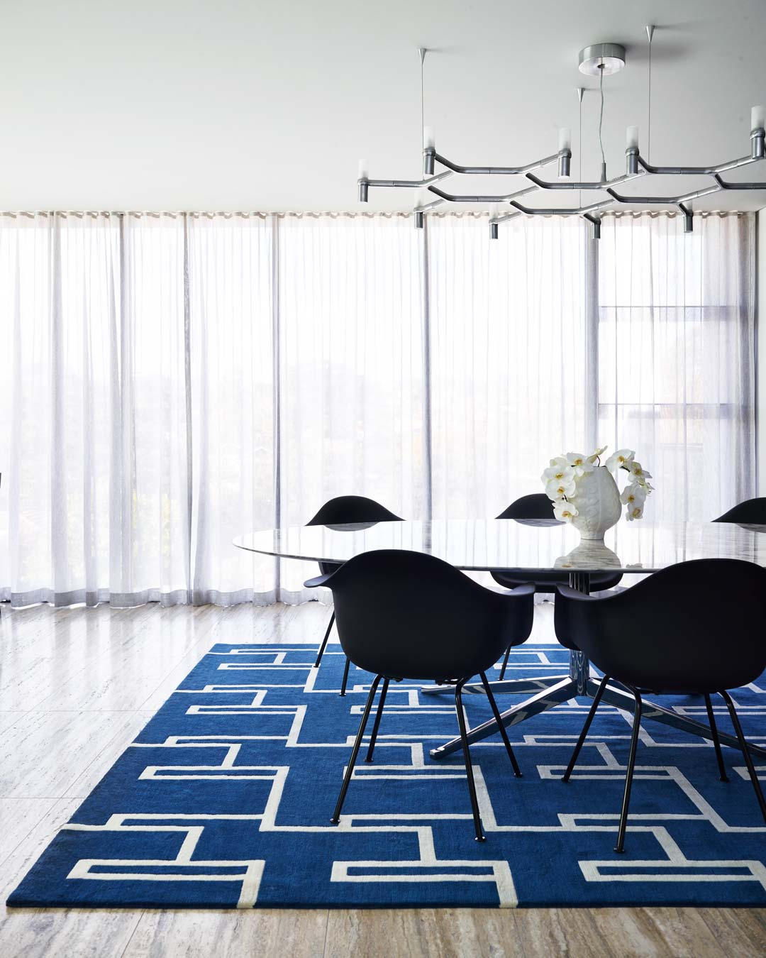 location dining room shot of miami rug by greg natale blue background white lines