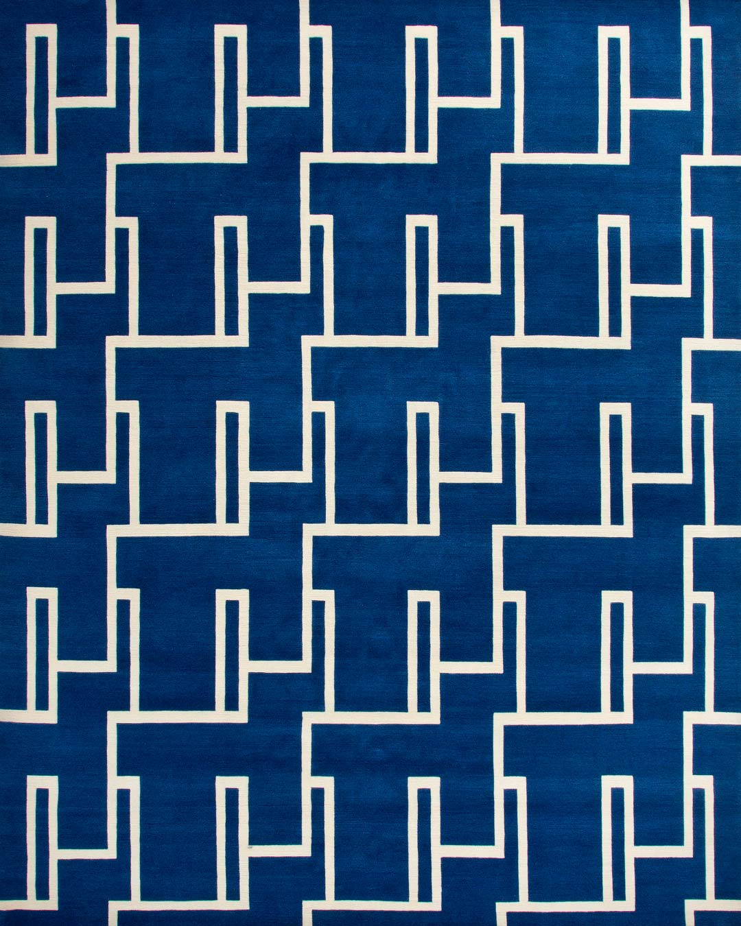 overhead of miami rug by greg natale blue background white lines