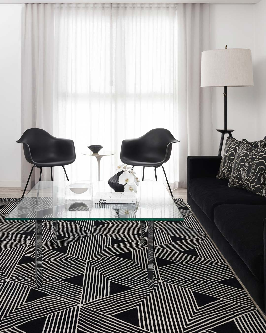 location shot of tokyo rug by greg natale white geometric lines on black background