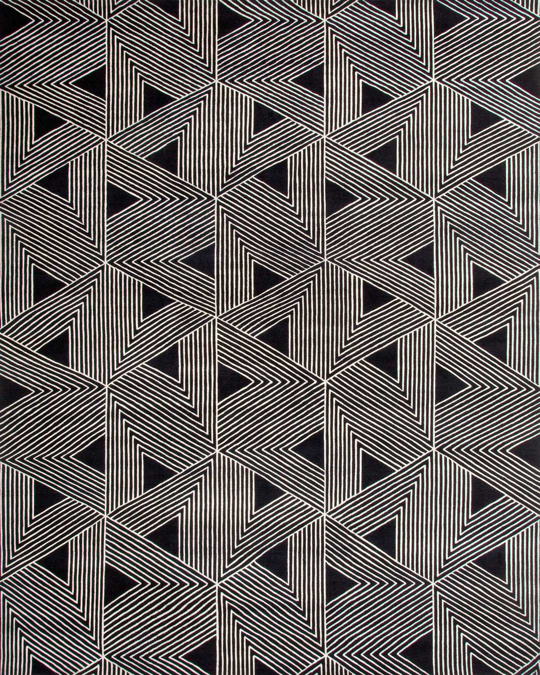 overhead of tokyo rug by greg natale white geometric lines on black background