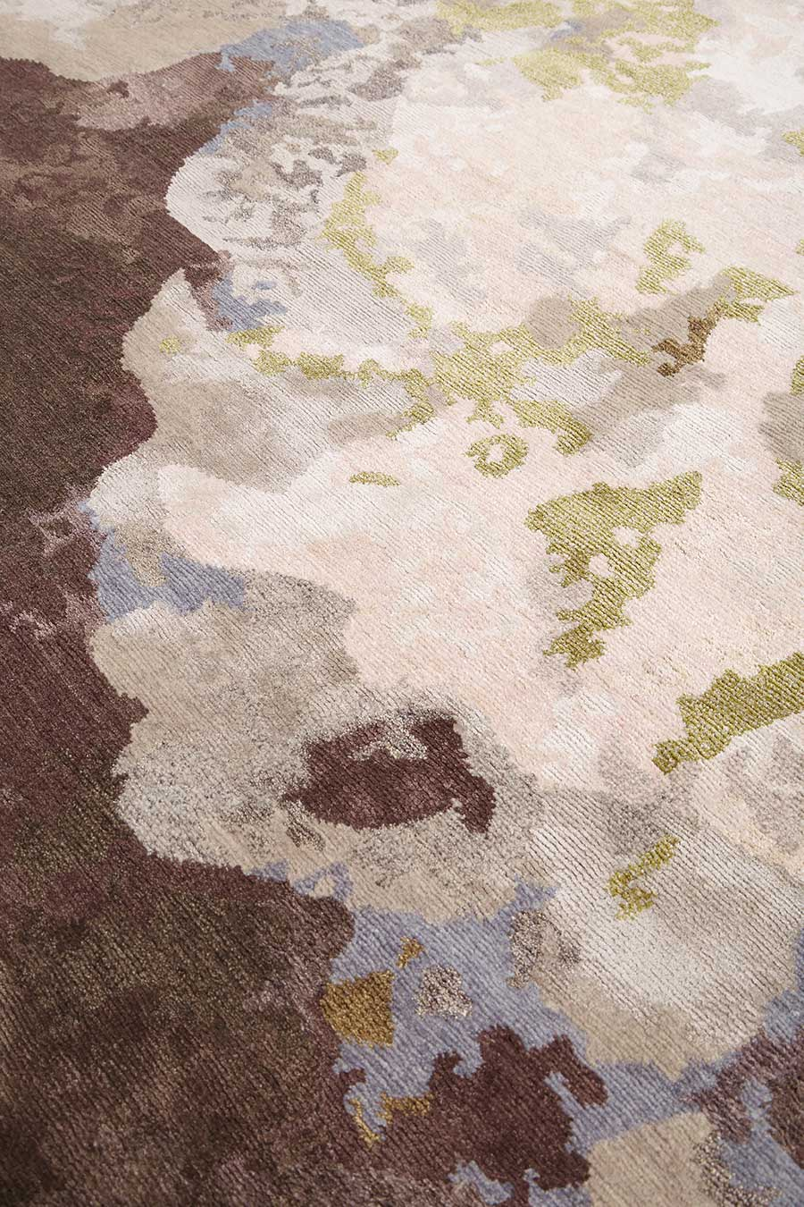 Close up image of multicoloured Botanic handknot rug by Hare + Klein