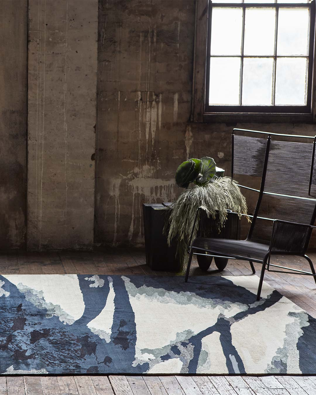 Styled image of painterly Canopy rug by Hare + Klein