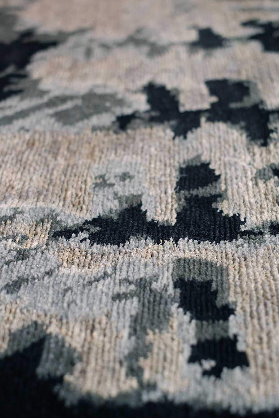Detailed image of abstract Etched rug by Hare and Klein in grey