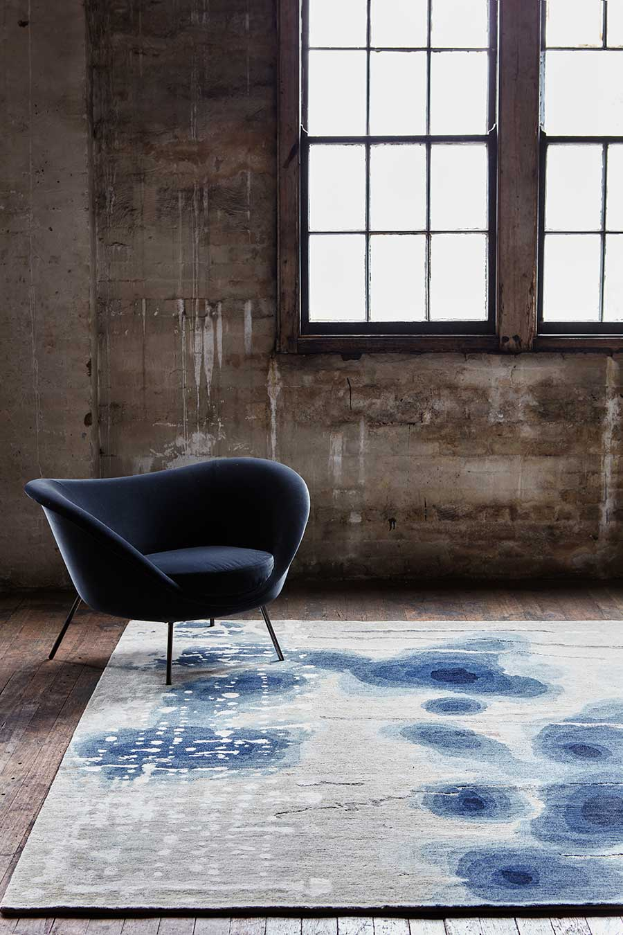 Styled image of painterly Inkblot handknot rug by Hare + Klein