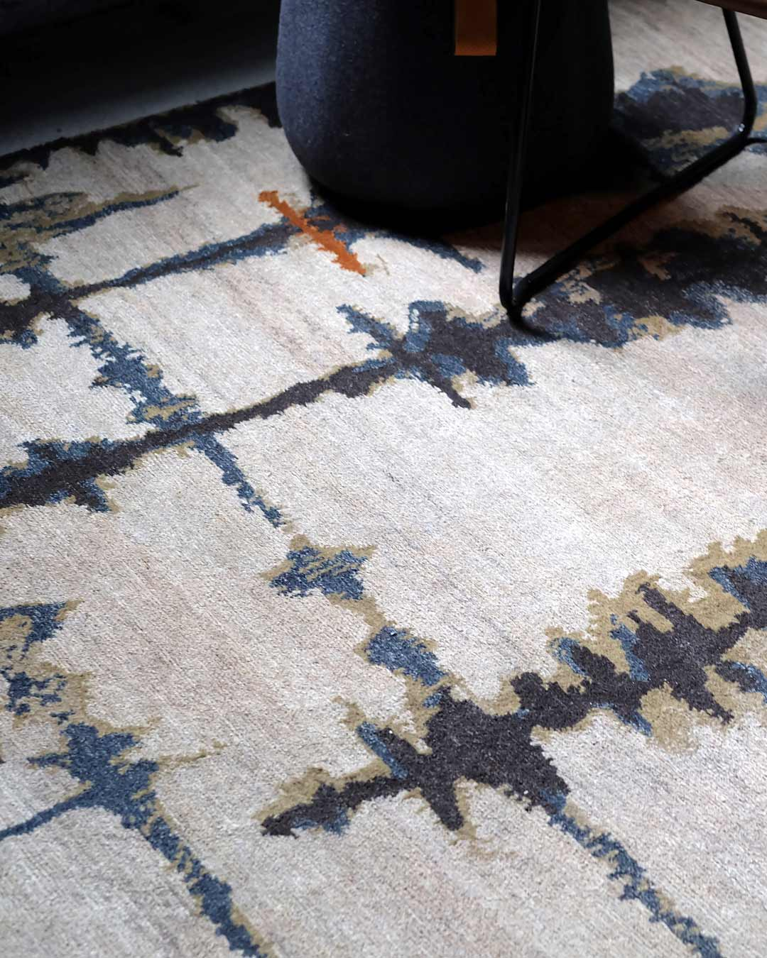 Detailed image of abstract Inlets handknot rug by Hare and Klein in beige colour