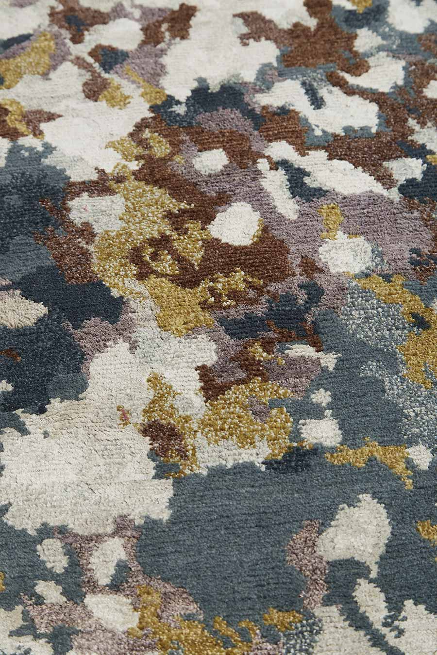 Detailed image of painterly Moss rug by Hare + Klein