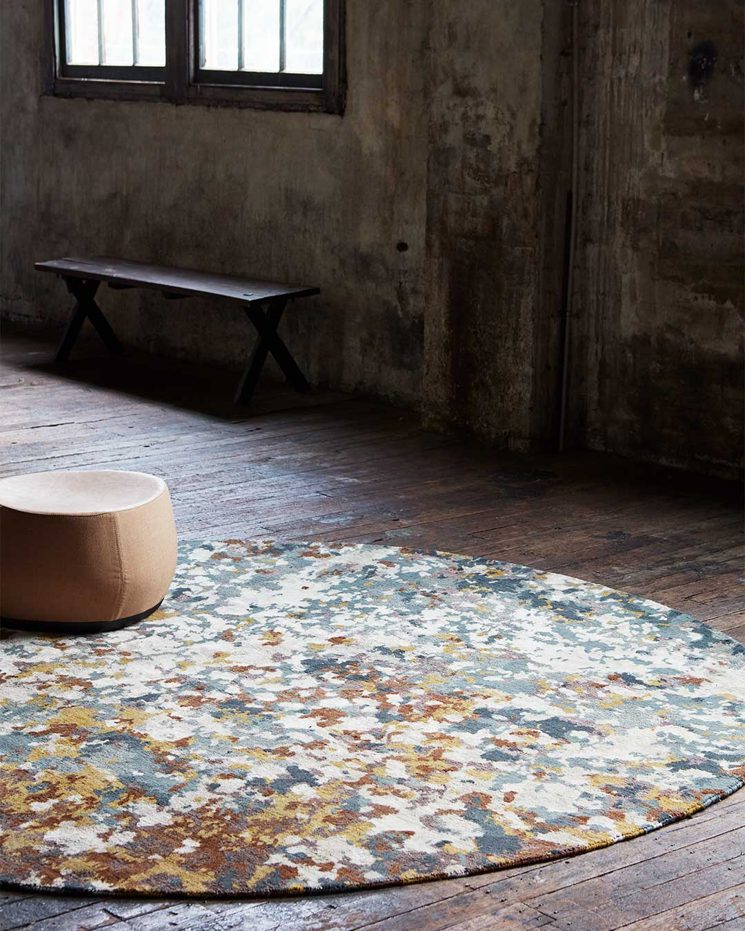 Styled image of painterly Moss rug by Hare + Klein