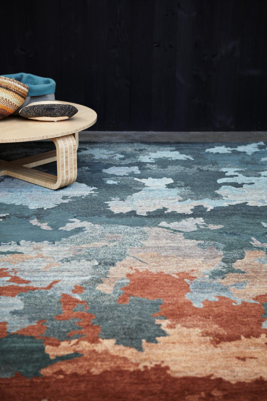 Styled image of organic Shadows handknot rug by Hare and Klein in blue colour
