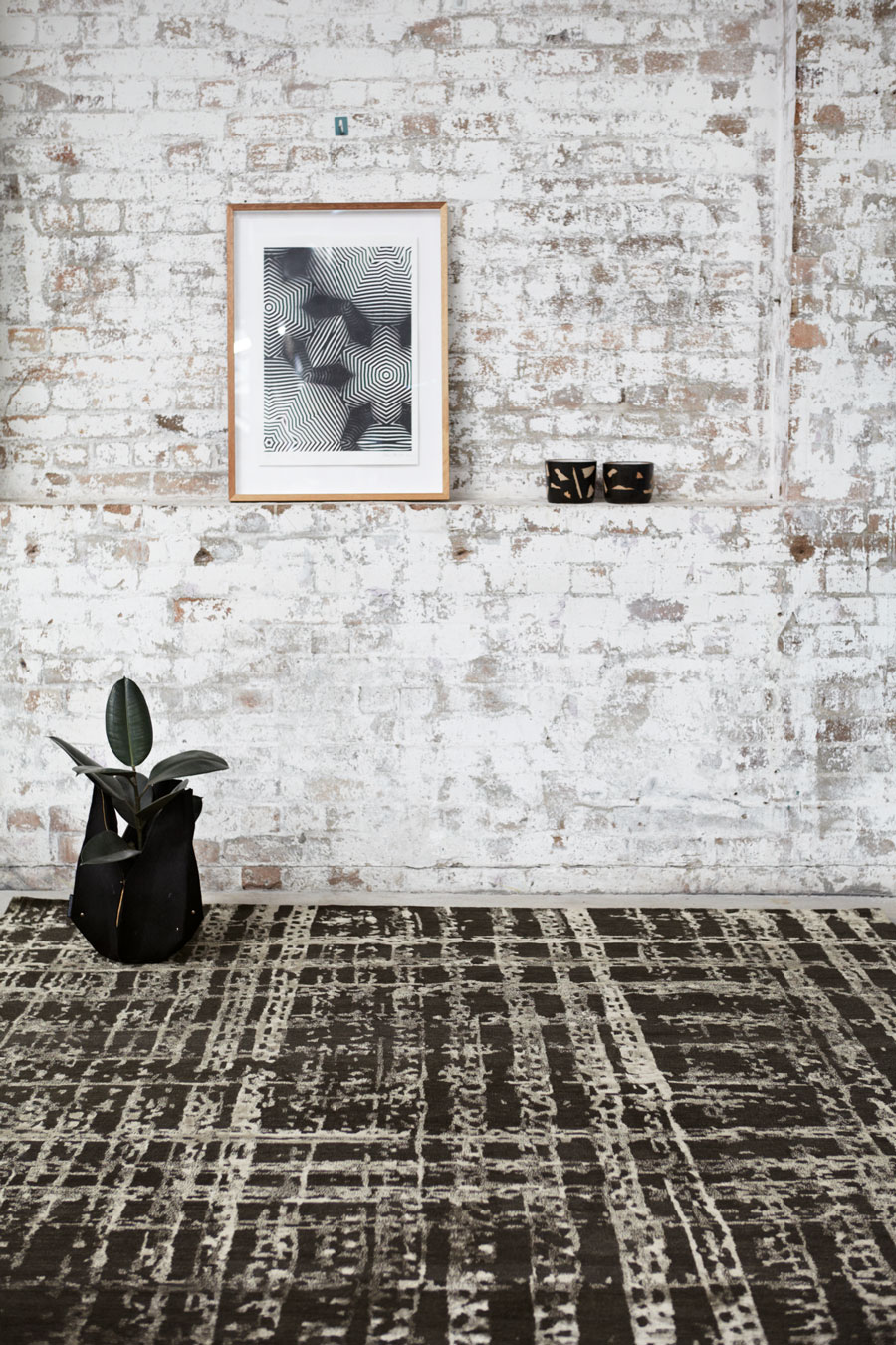 Styled image of textured Twine rug by Hare + Klein in brown colour