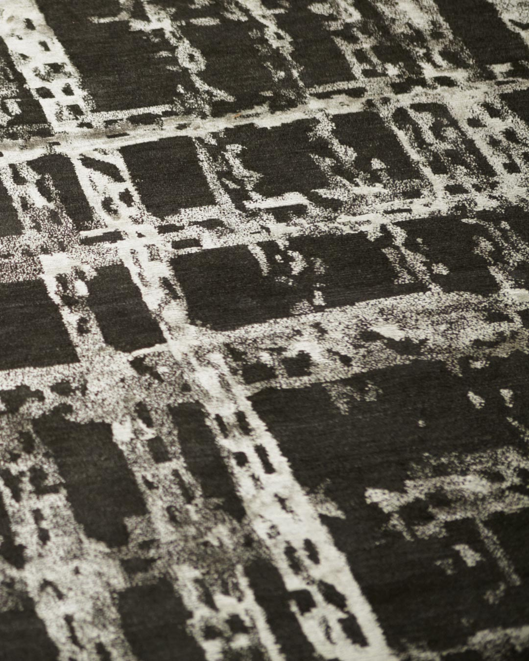 Detailed image of textured Twine rug by Hare + Klein in brown colour