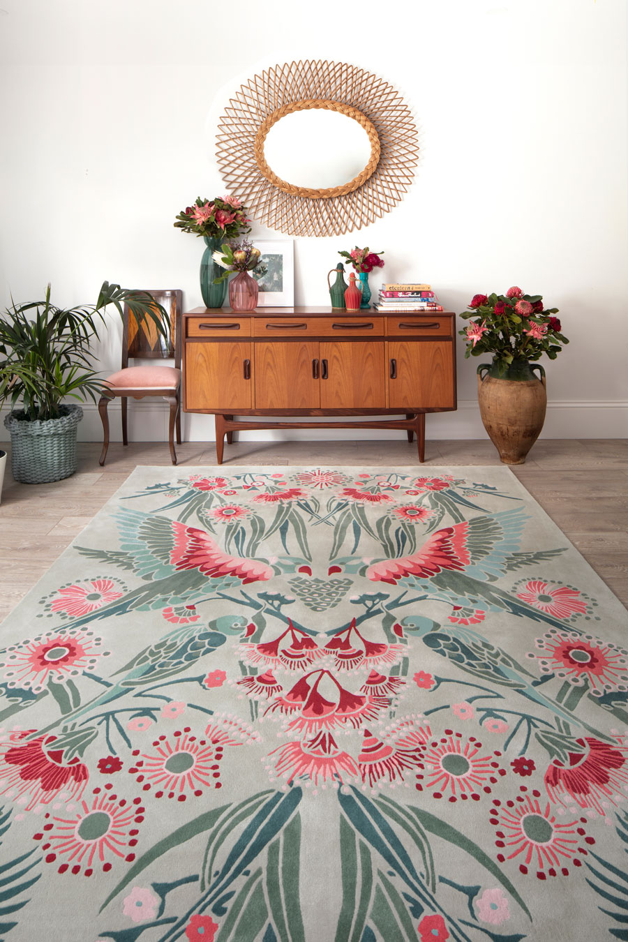 Overhead image of floral Gumnut Paradise rug by House Of Heras in mint green colour