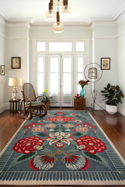 Living room image of floral Waratah Wonderland rug by House Of Heras in green colour