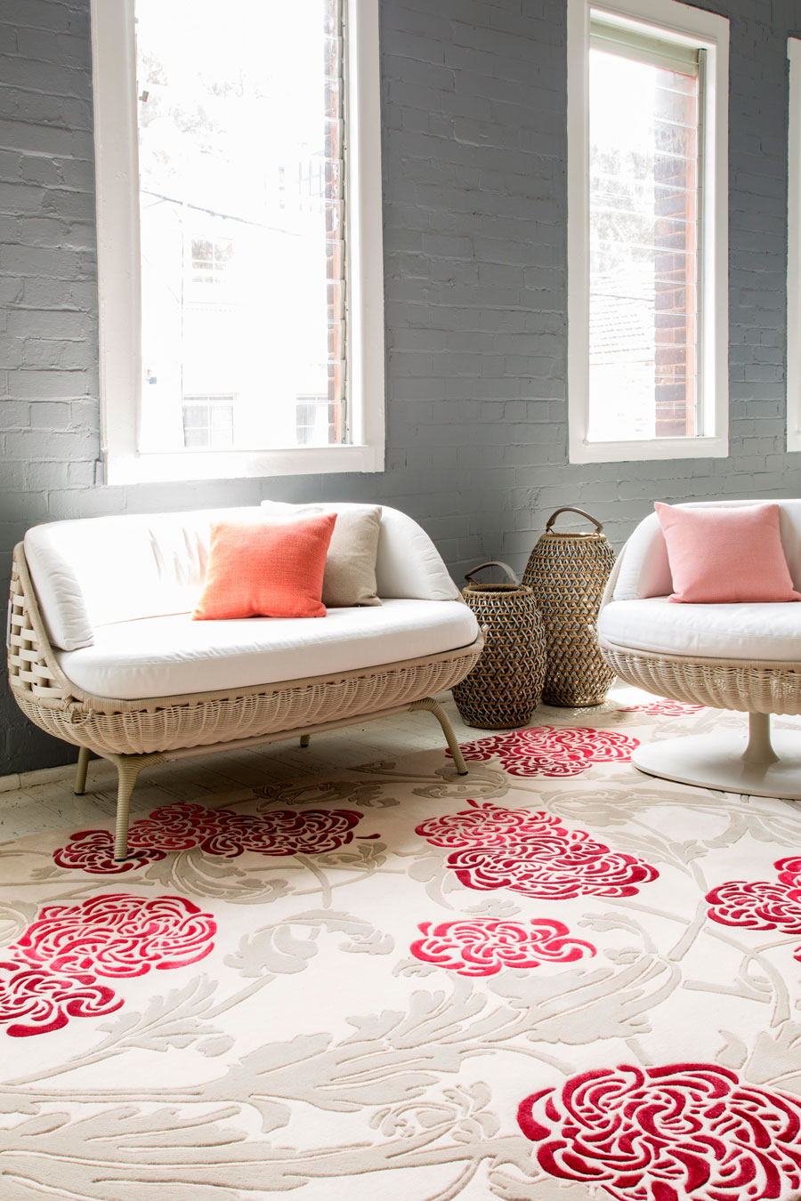 Living room image of floral Chrysanthemum rug in pink and red colour