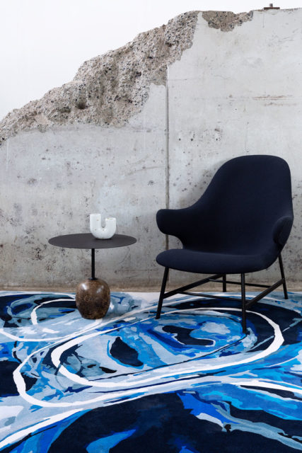 Styled image of painterly Deluge rug by Lara Scolari in blue colour