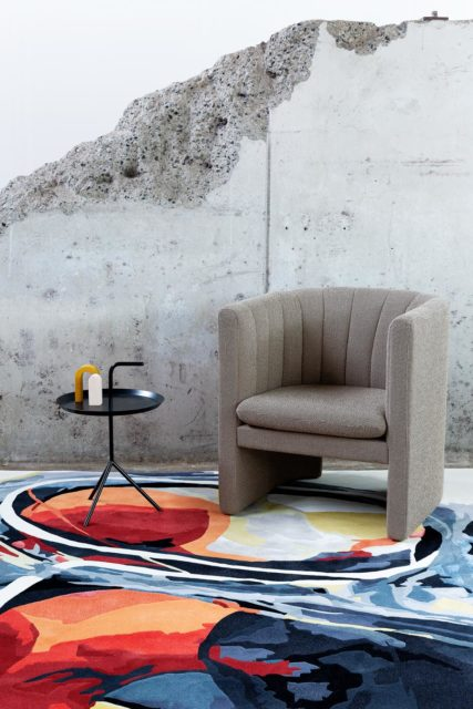 Styled image of painterly Grain Trader rug by Lara Scolari in orange colour