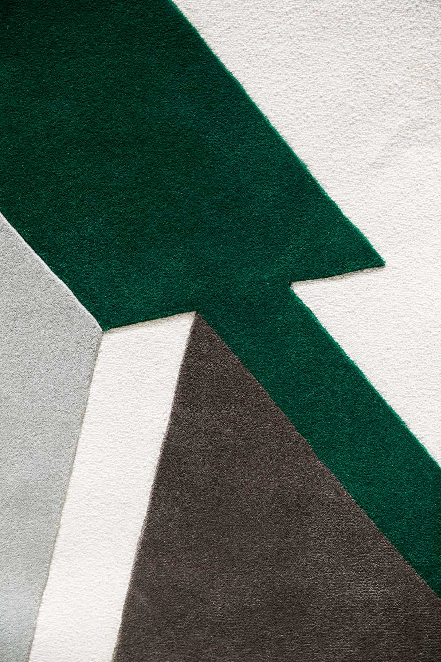 Detailed image of geometric Mortice and Tenon rug by Mr Frag in green colour