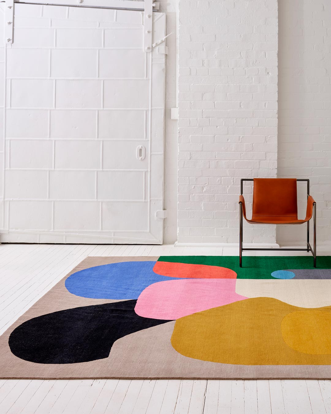 Entrance view of modern Crowded Room rug by Stephen Ormandy