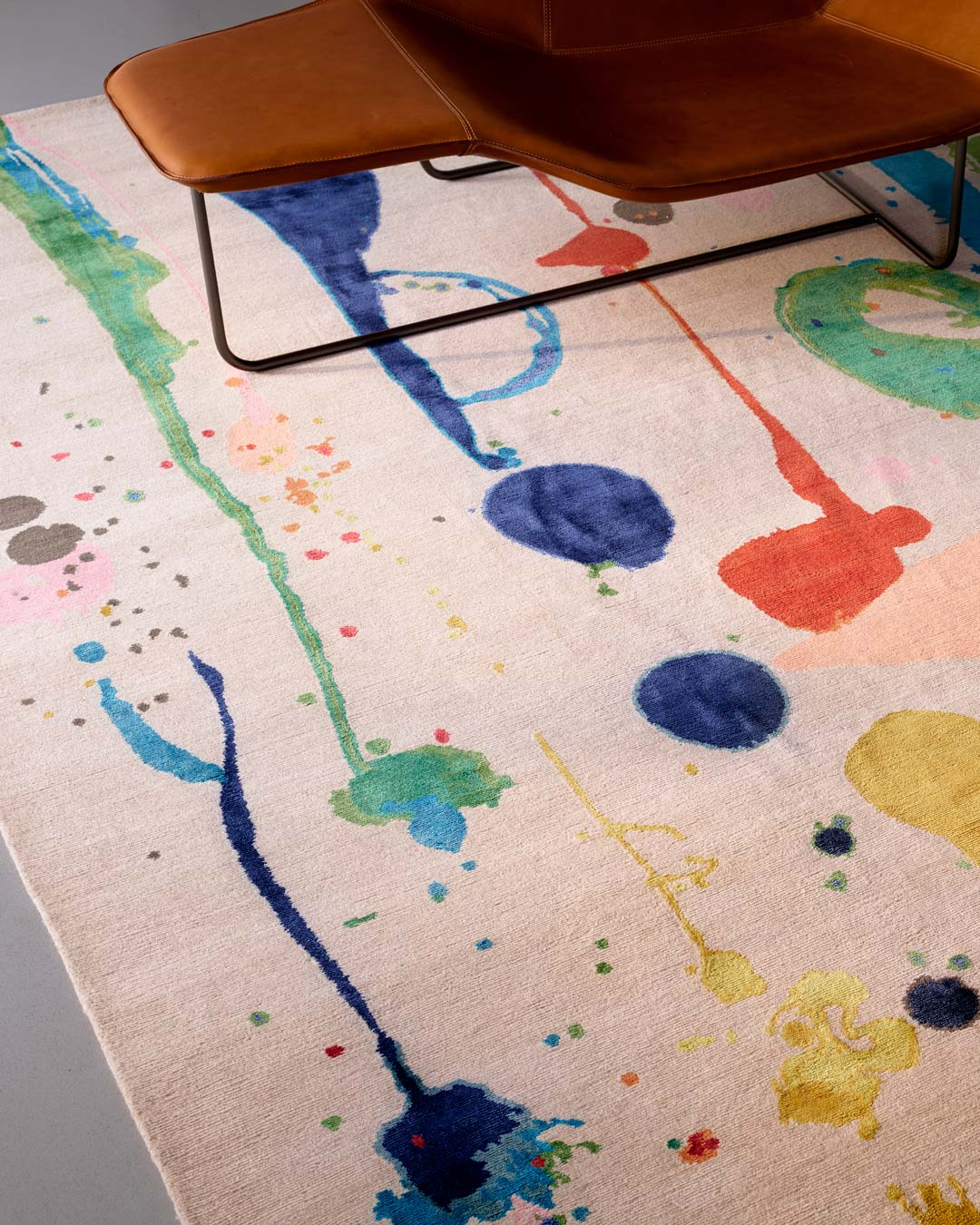 Close up image of painterly Dream Garden rug by Louise Olsen