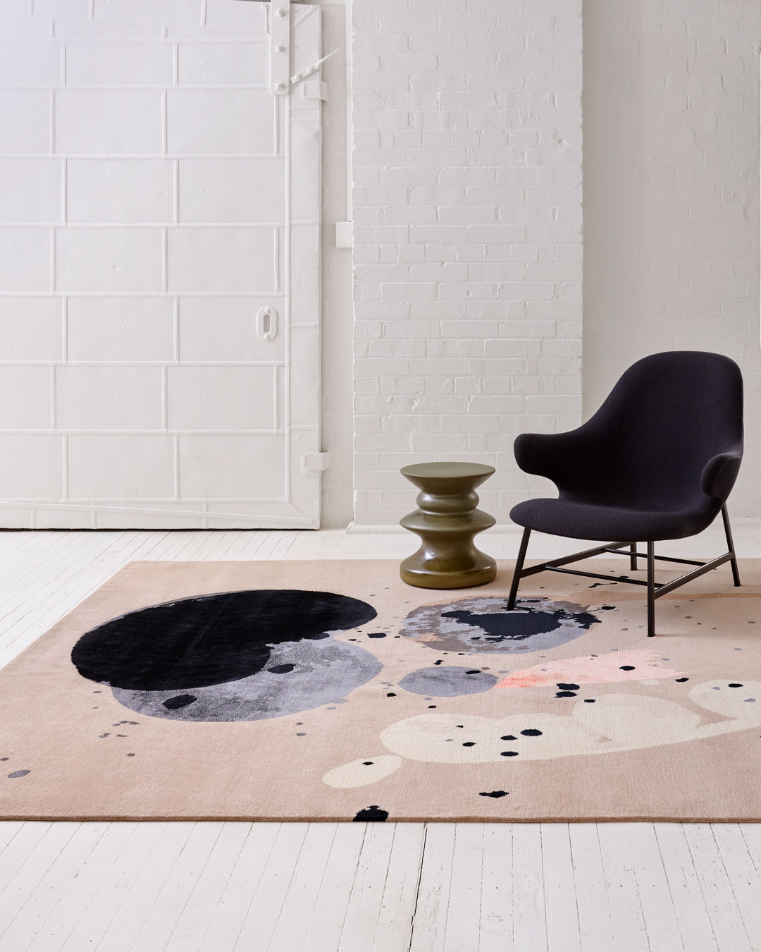 Living room image of painterly Seed Pod rug by Louise Olsen in grey colour