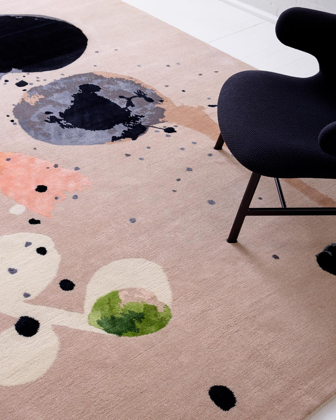 Close up image of painterly Seed Pod rug by Louise Olsen in grey colour
