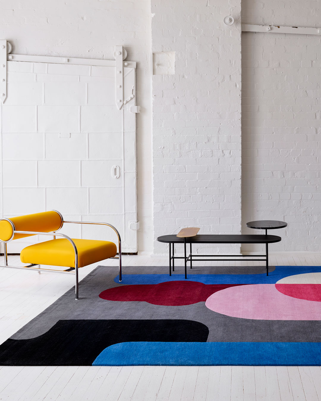 Styled image of geometric Twilight rug by Stephen Ormandy