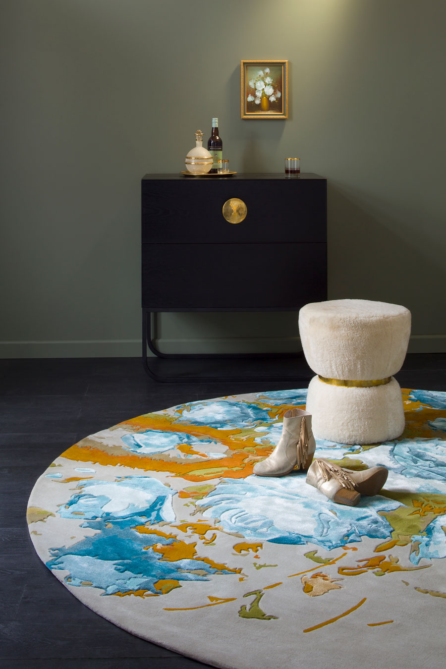 Styled image of floral Mavis rug in blue colour