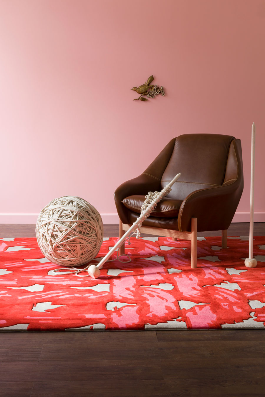 Living room image of Purls of Wisdom rug in red colour