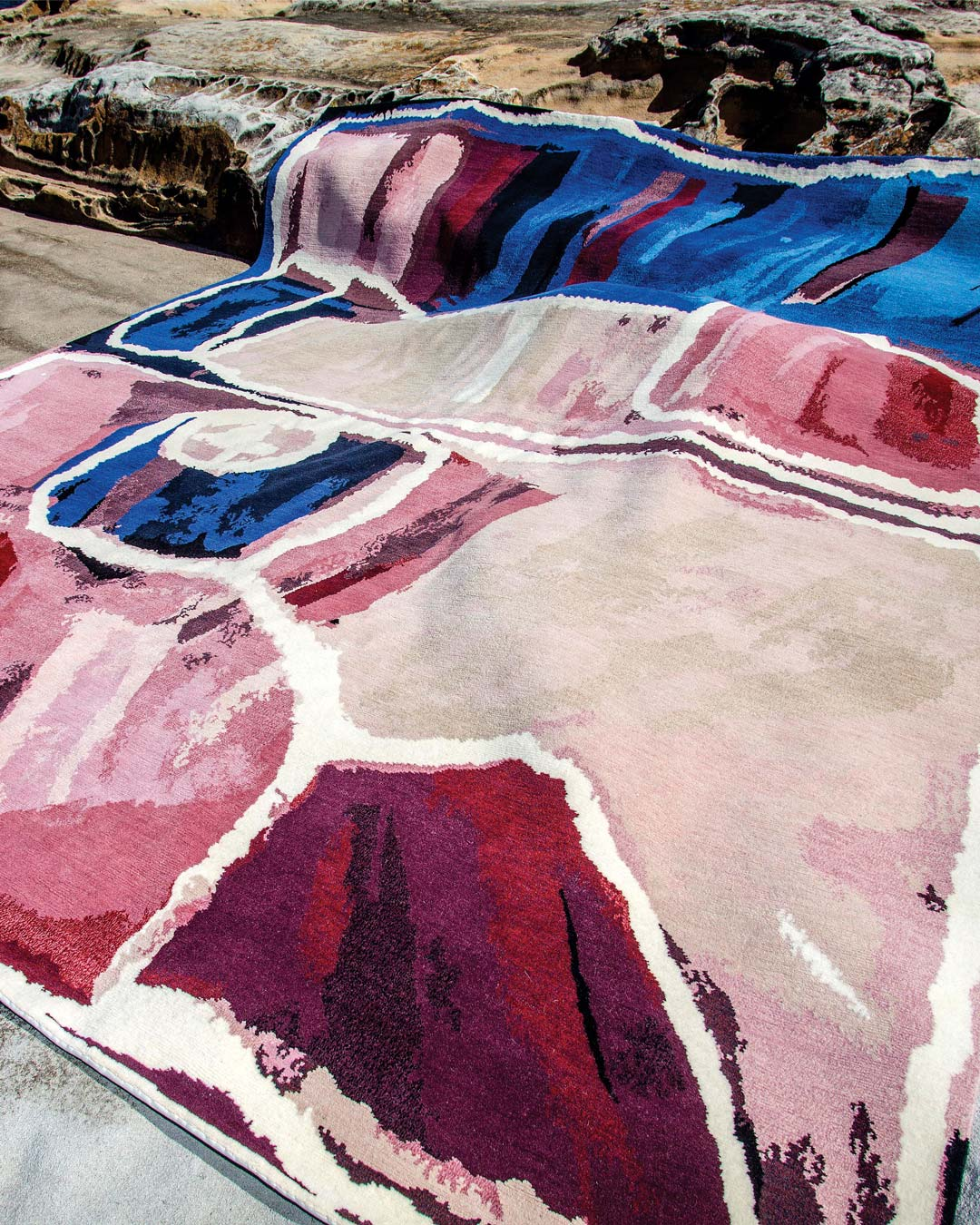 Indigenous rug Kirriwirri in blue and pink colour in a coastal setting