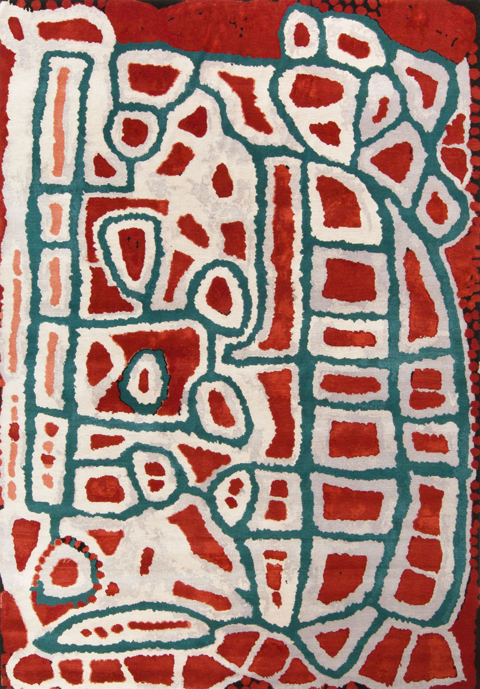 Overhead view of indigenous Lungarung rug in red and green colour