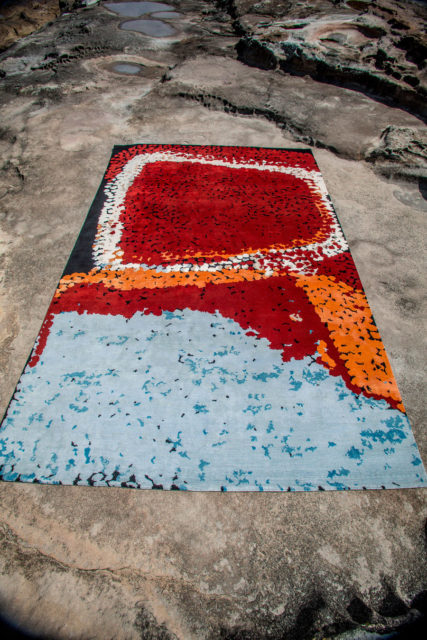 Overhead view of indigenous Lungarung rug in red colour