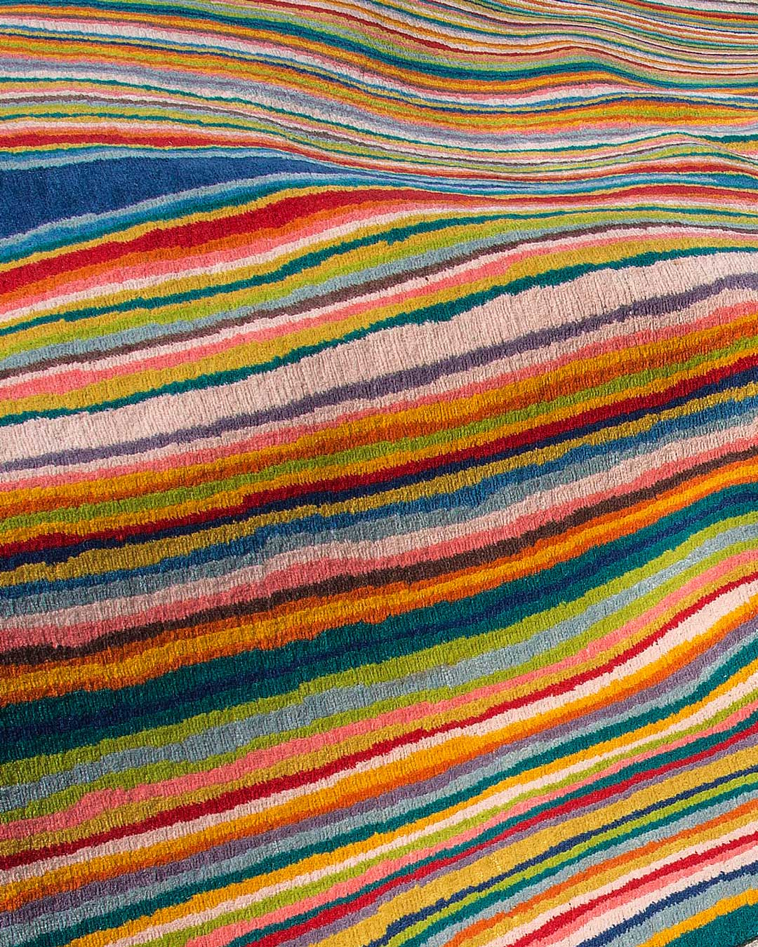 Detailed view of indigenous Untitled 2006 rug in rainbow colours