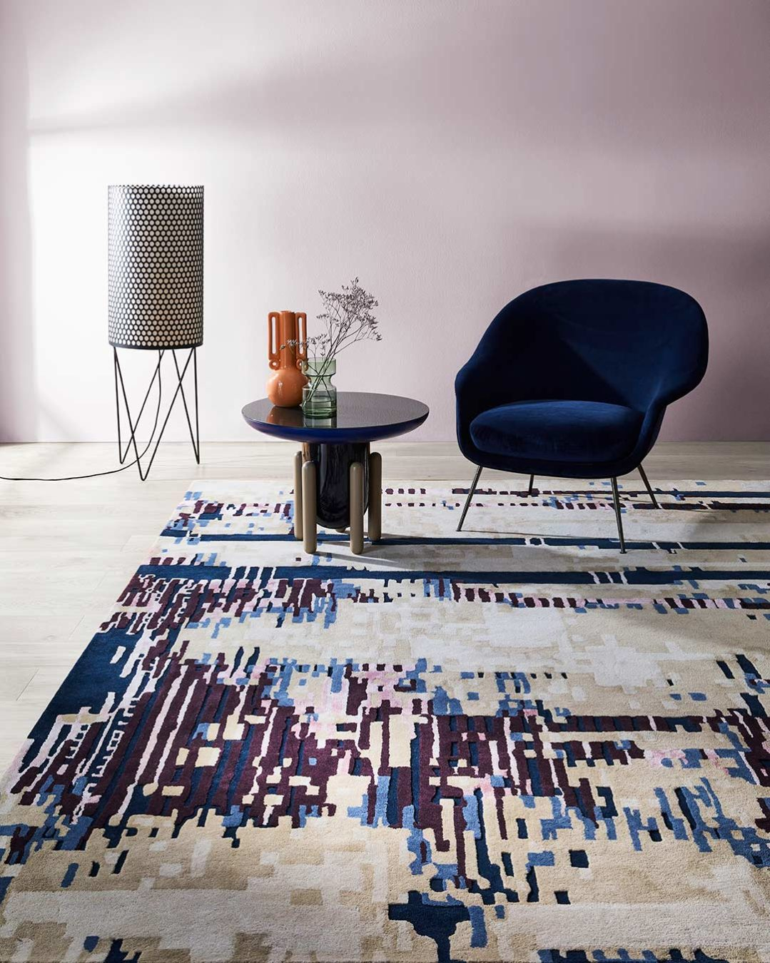 Living room view of modern abstract Alexia rug in pink, purple, beige and charcoal