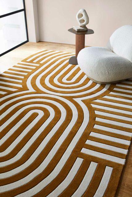 Living room view of modern, art deco Walter rug in mustard.