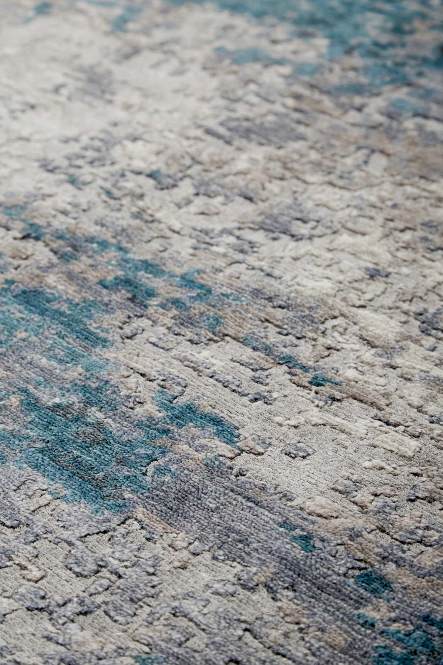 Detailed image of textural Aria rug in blue colour