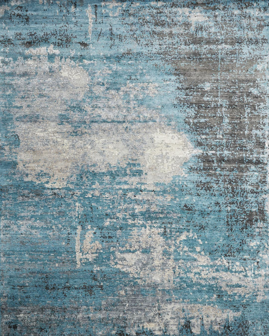 Overhead image of textural Aria rug in blue colour