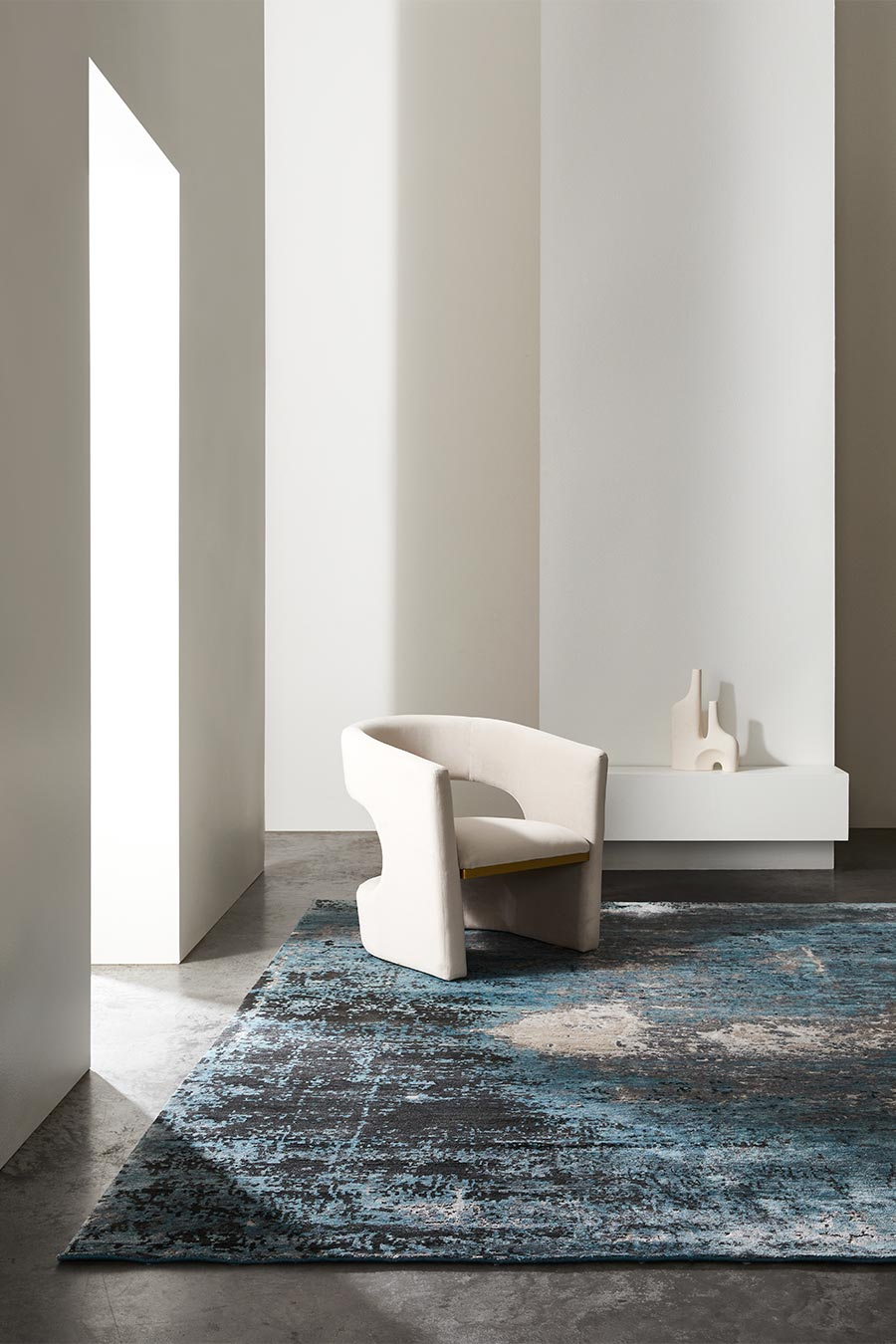 Living room image of textural Aria rug in blue colour
