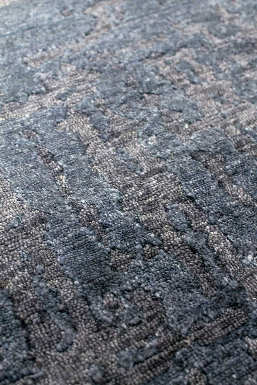Detailed image of textural Boho rug in navy blue colour