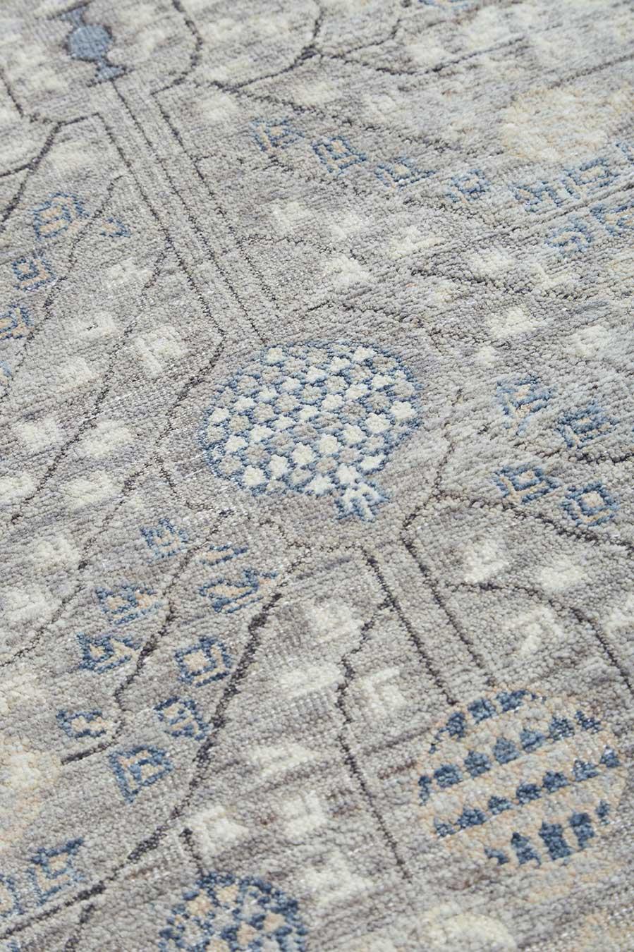 Close up image of traditional grey Cordoba rug