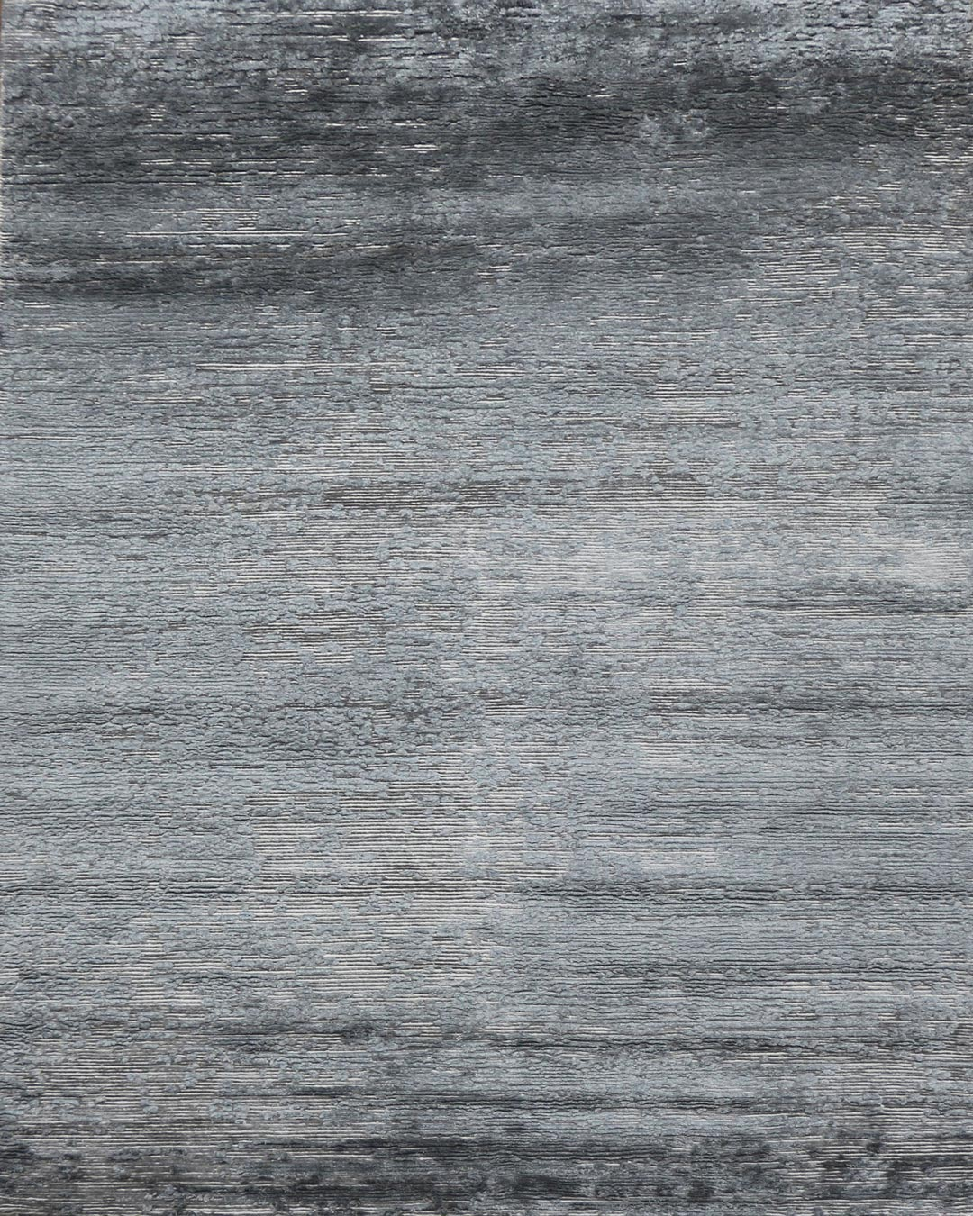 Overhead view of textured Dolomite rug in silver colour