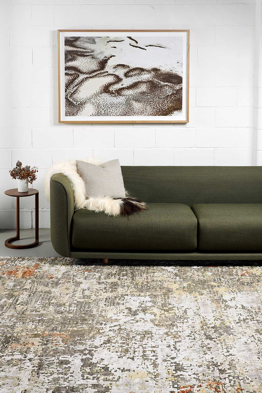 Living room view of charcoal Harissa rug in grey colour
