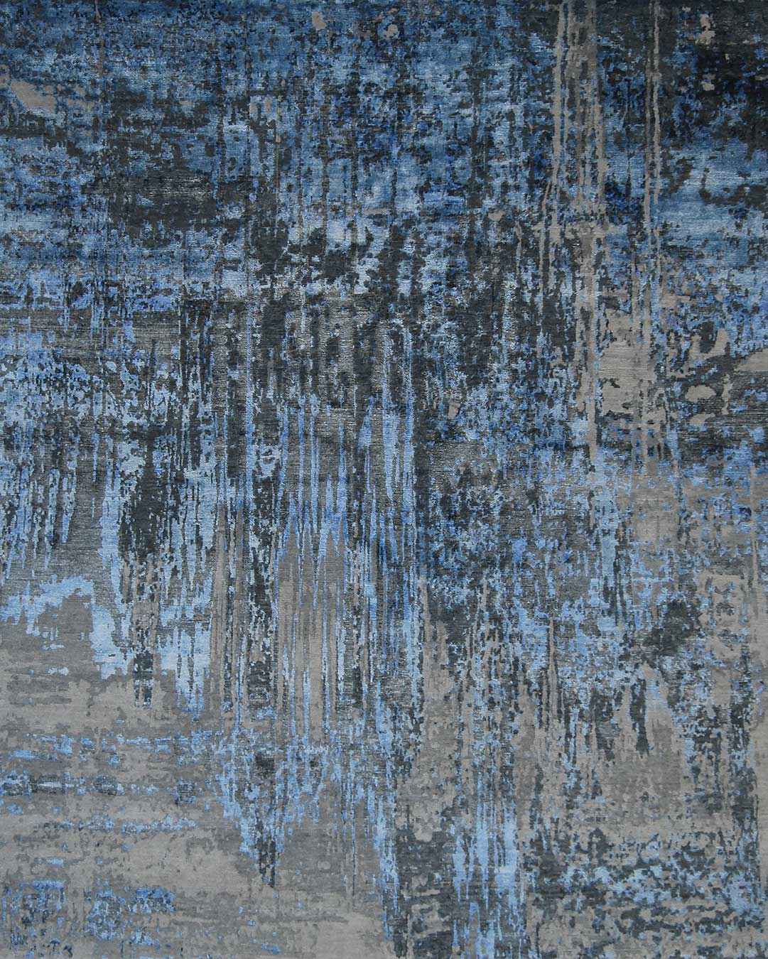 Overhead image of distressed Lake rug on blue colour
