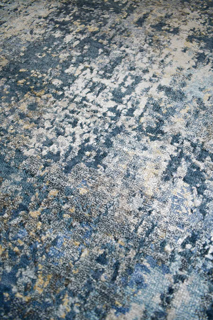 Detailed image of distressed Lamancha rug in navy blue colour