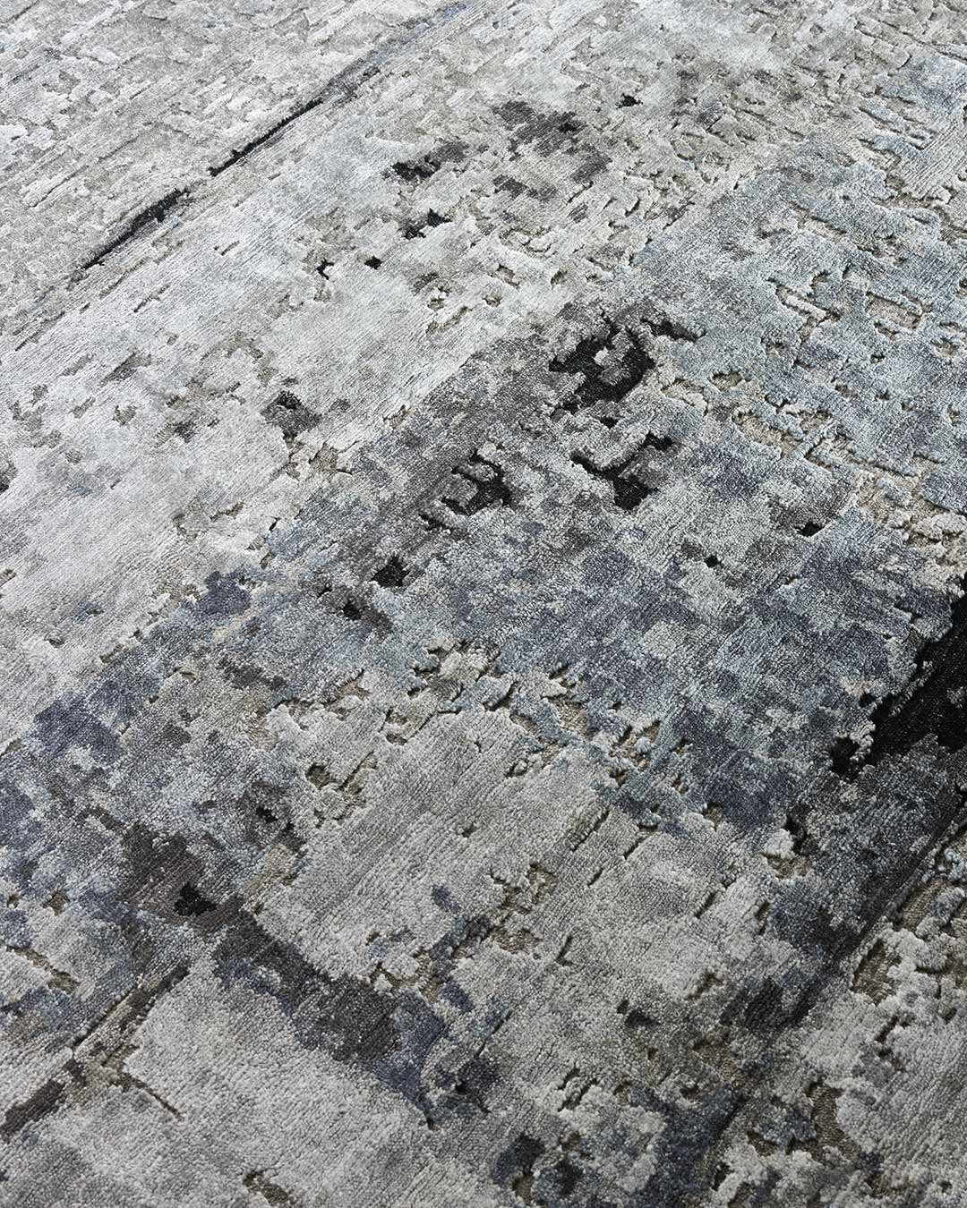 Detailed image of distressed Orion rug in beige and blue colour