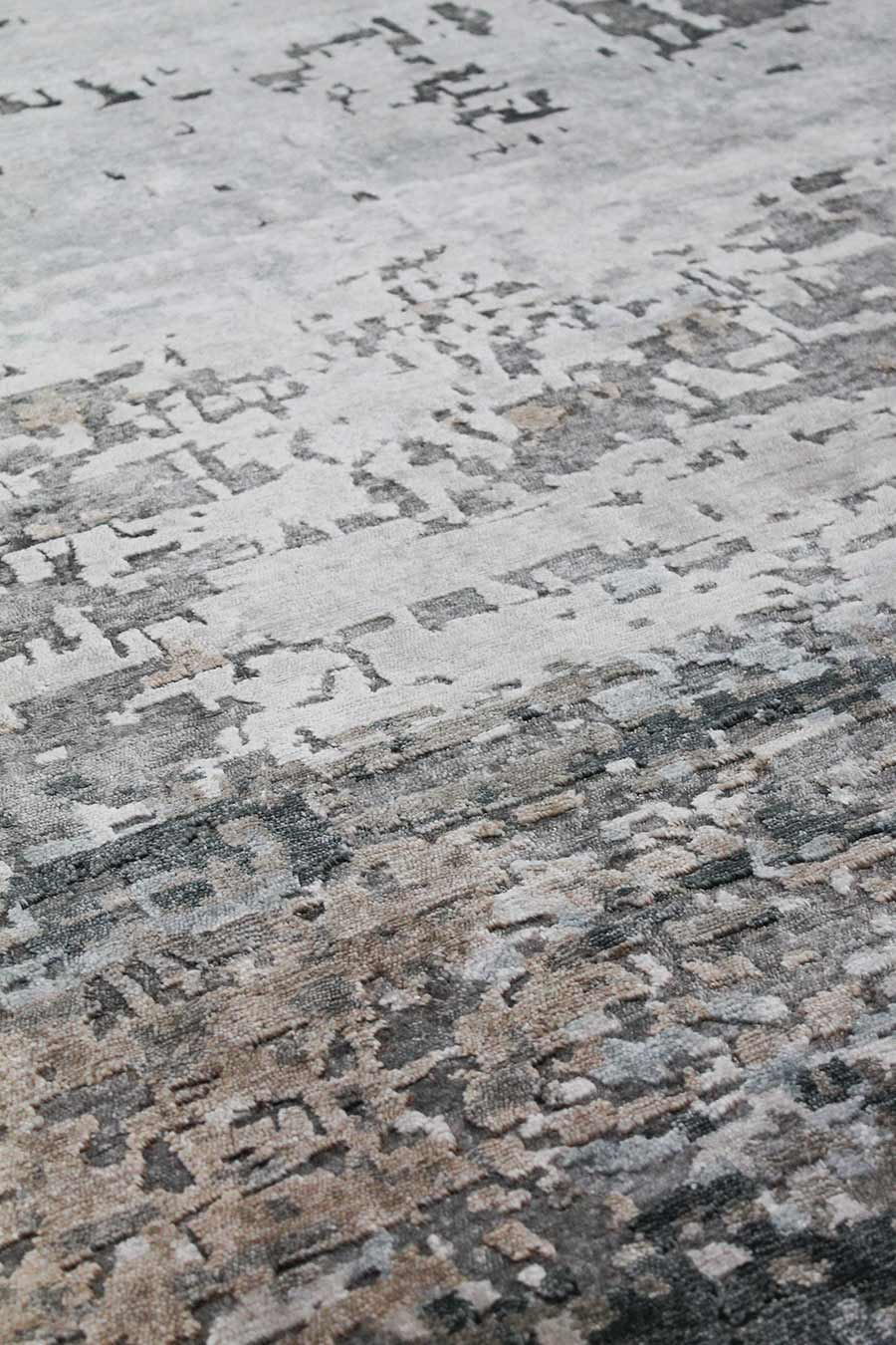 Detailed image of distressed Orion rug in grey and blue colour