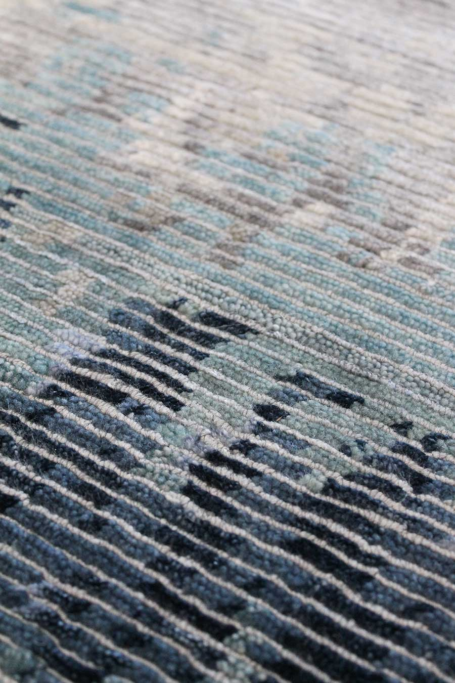 Detailed image of distressed Rainstorm rug in blue colour