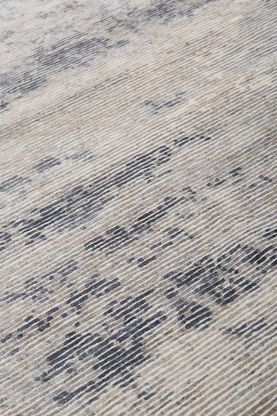 Detailed image of distressed Seamist rug in grey colour