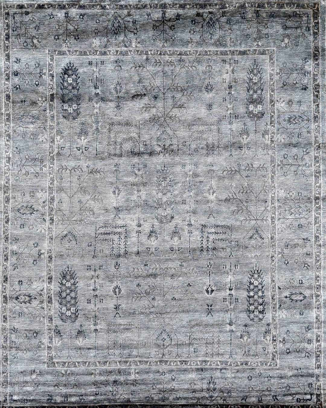 Overhead image of traditional Sultaman rug in grey colour