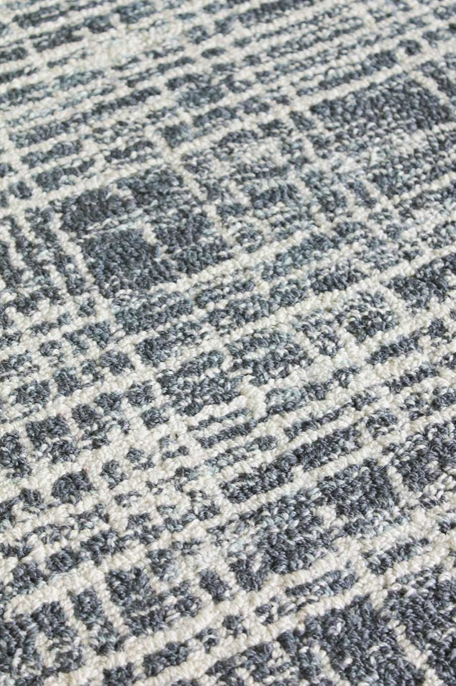 Detailed image of textured Burlap rug in blue colour
