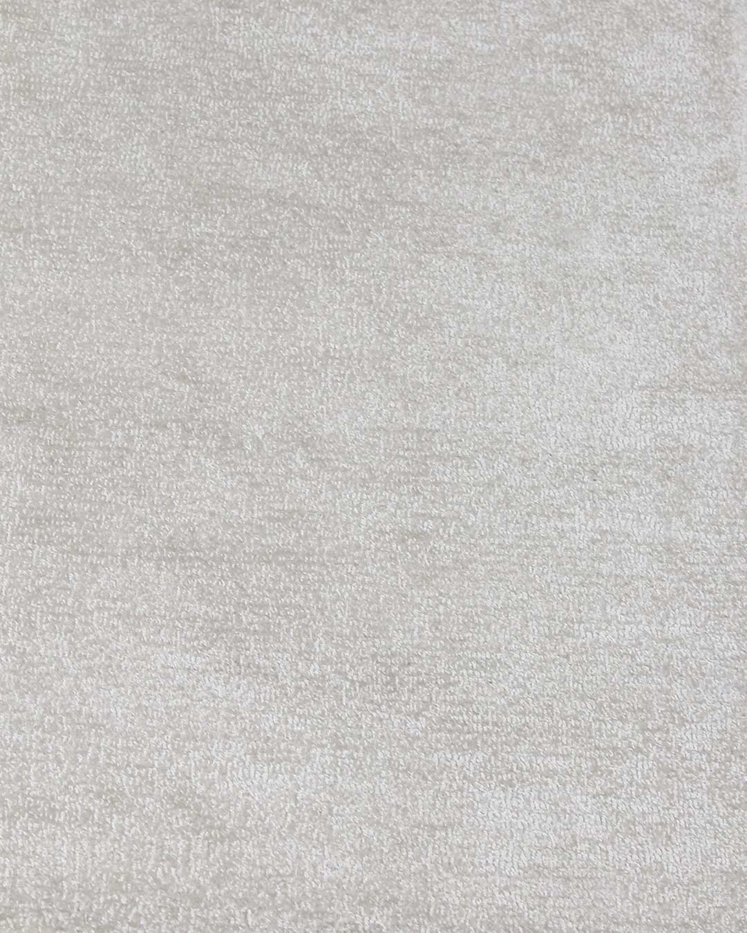 Close up view of textured Carlton rug in cream colour