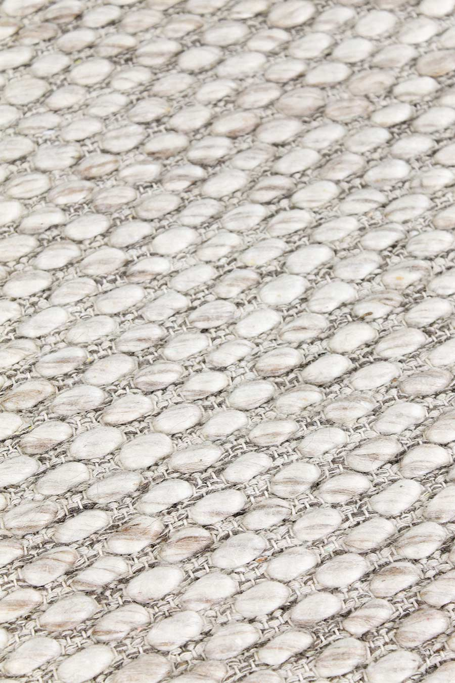 Detailed view of textured Cocos rug in beige colour
